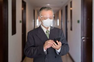 mature-japanese-businessman-with-mask-and-face-shi-M498PKU